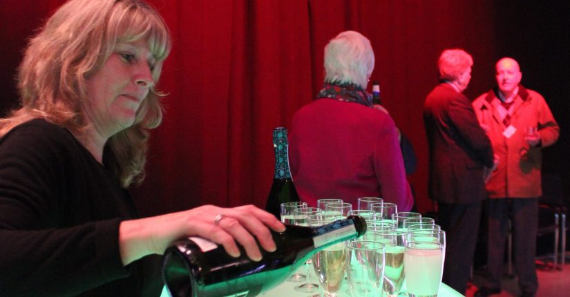 woman pouring champagne at event