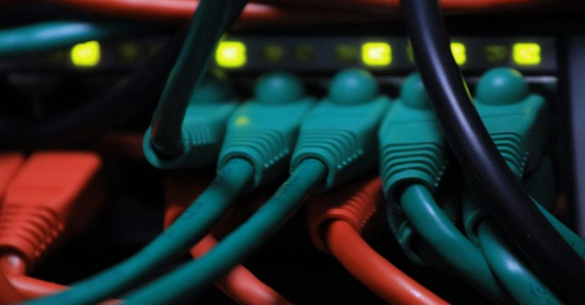 Colored network Cables plugged in to ports